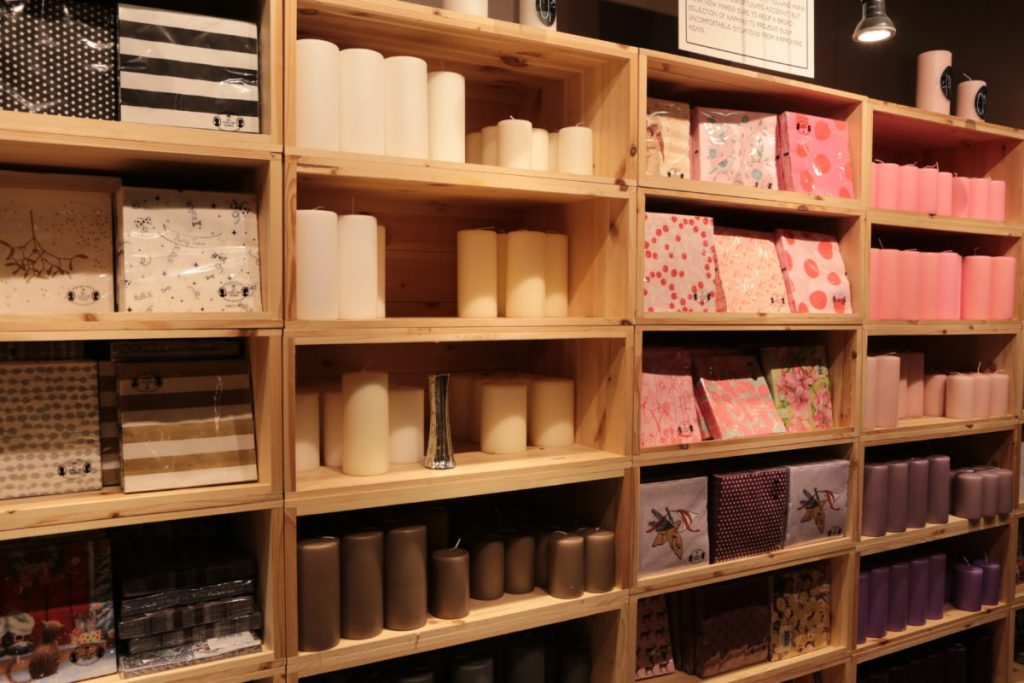 Shelves filled with candles and napkins
