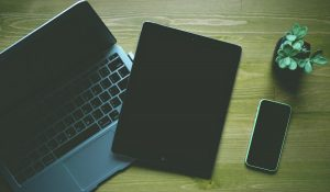 Laptop, iPad, iPhone on desk