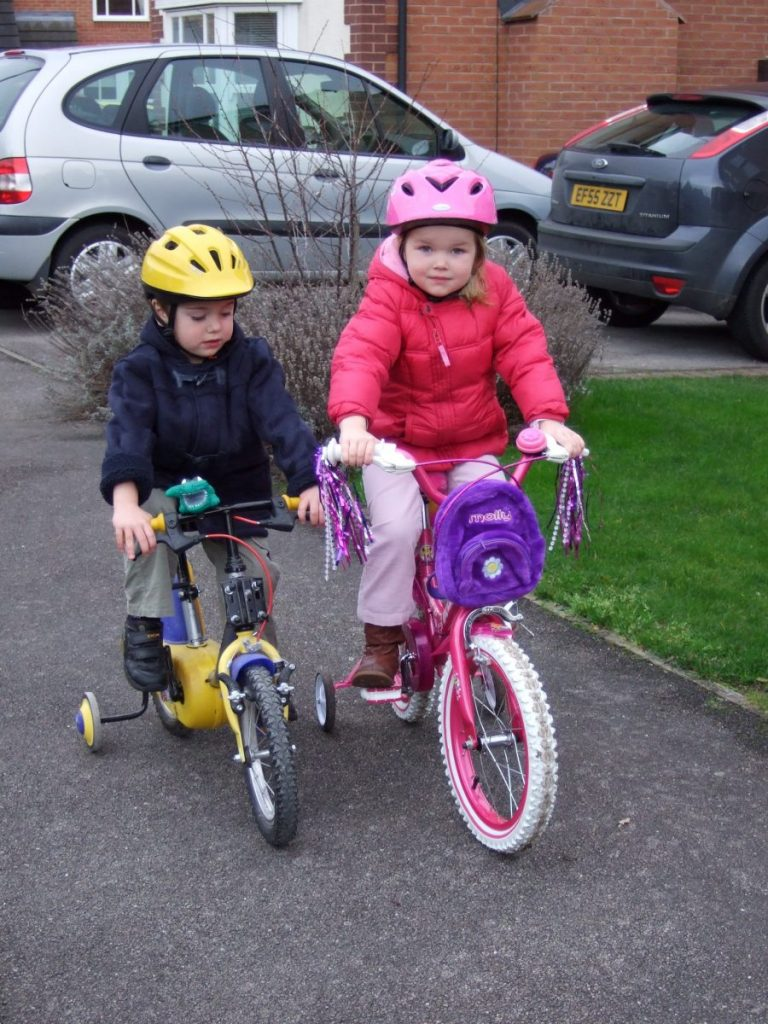My daughter Beth on her bike with her Cousin Thomas on