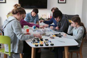 The Lego Christmas Tradition: The Taylor Family gathered around the table to build their Christmas Lego kit, the Lego Volvo EW160E