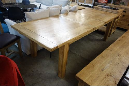 Oak extending table at Arthur Johnson Auction