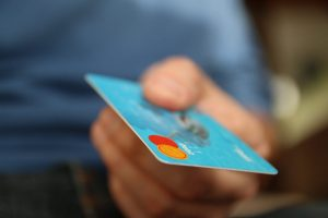 ClearScore have published a guide on personal loans. Close-up of hand holding a credit card