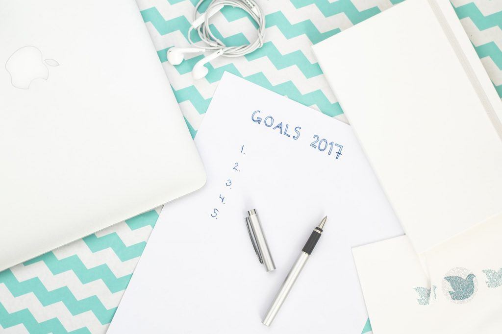 Paper and pens on a table with Goals and resolutions for 2017