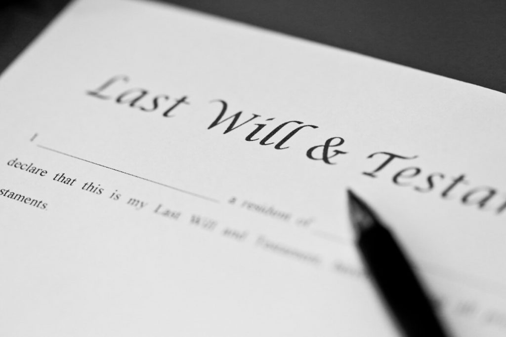 Pen resting on Last Will & Testament document: Article on 10 reasons why you need to write a will and Free will