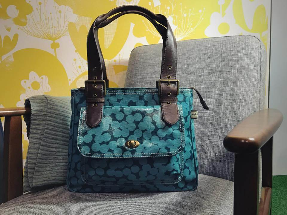 Sophia & Matt Shoulder Bag on chair Yayoi print.
