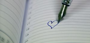 Love heart drawn on diary date in calendar