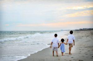 Children on a beach beside sea