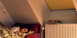 child in bed with velux blackout blinds