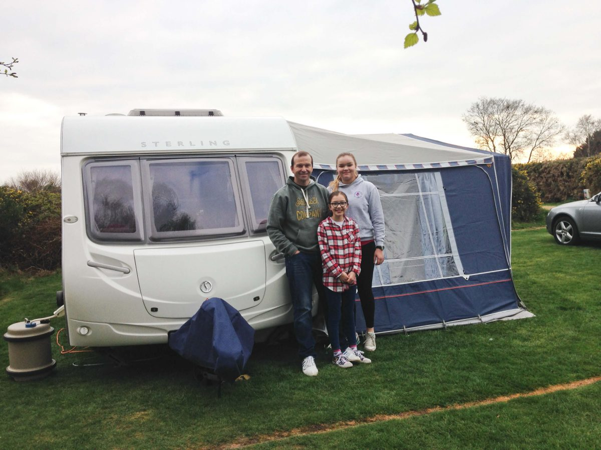 Our family in front of our touring caravan and awning