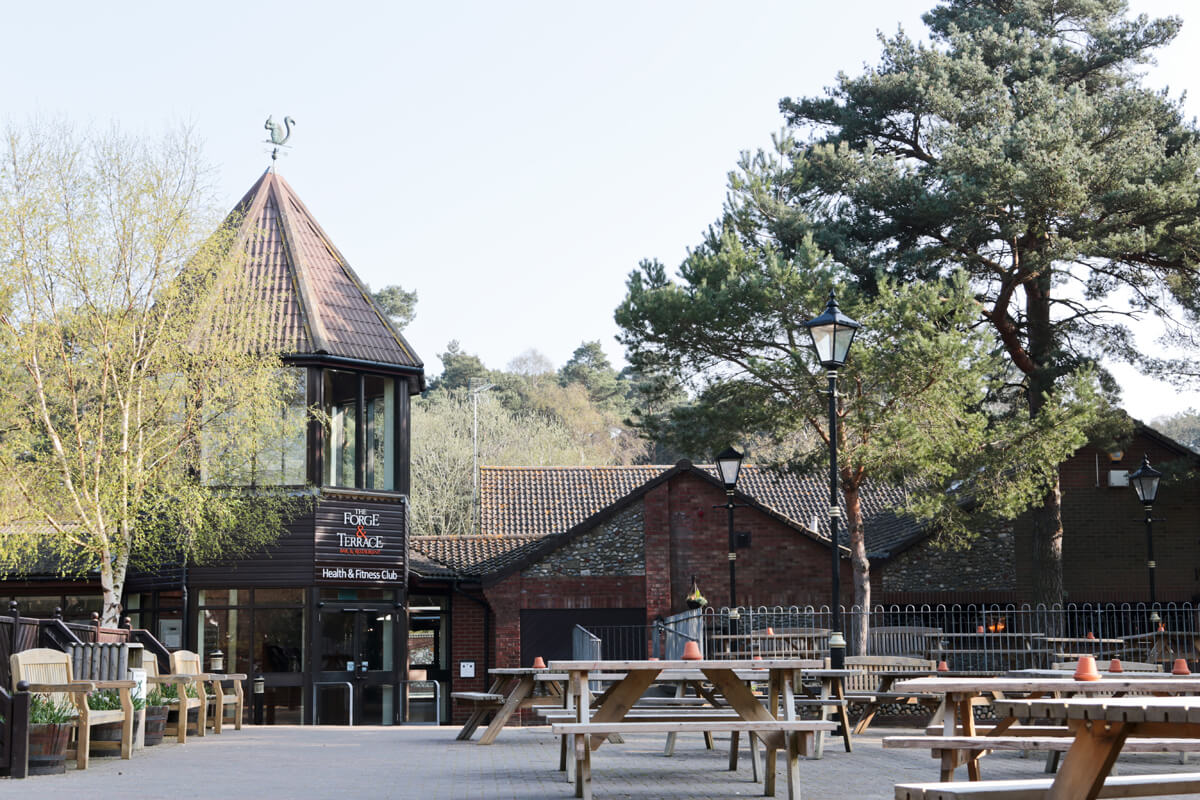 The Village Square at Kelling Heath with a view of the Health and Fitness Club and entrance to the Terrace and Forge Bars.