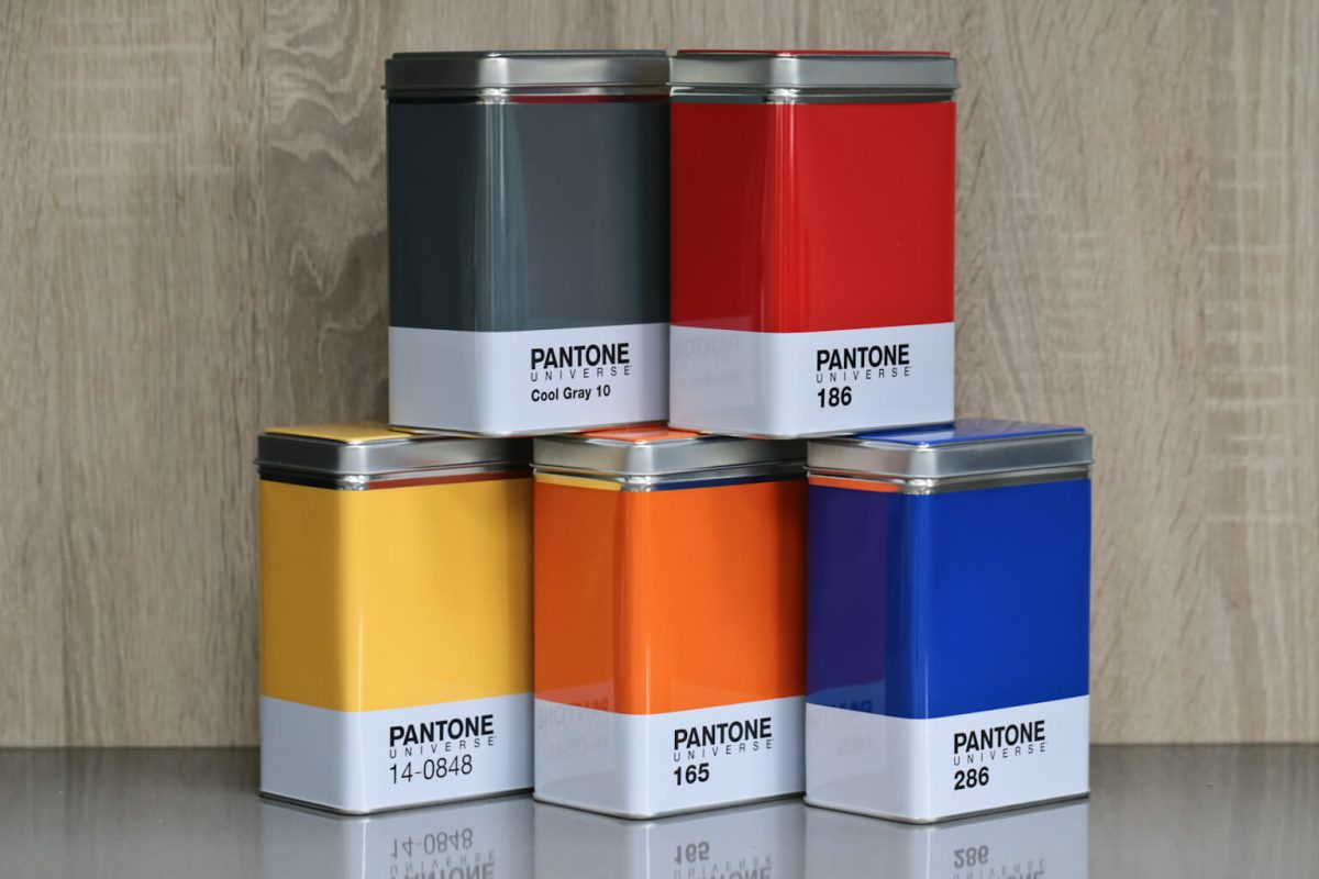 5 stacked Pantone Universe Kitchen storage containers / tins