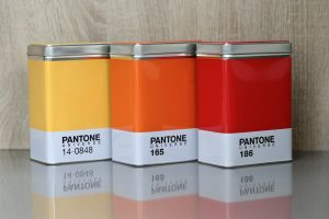 3 Pantone Universe Storage containers / tins in Yellow, Orange and Red hues.