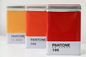 Pantone Universe Kitchen Storage Containers / Tins. Red Orange and Yellow Pantone Storage tins fading into distance