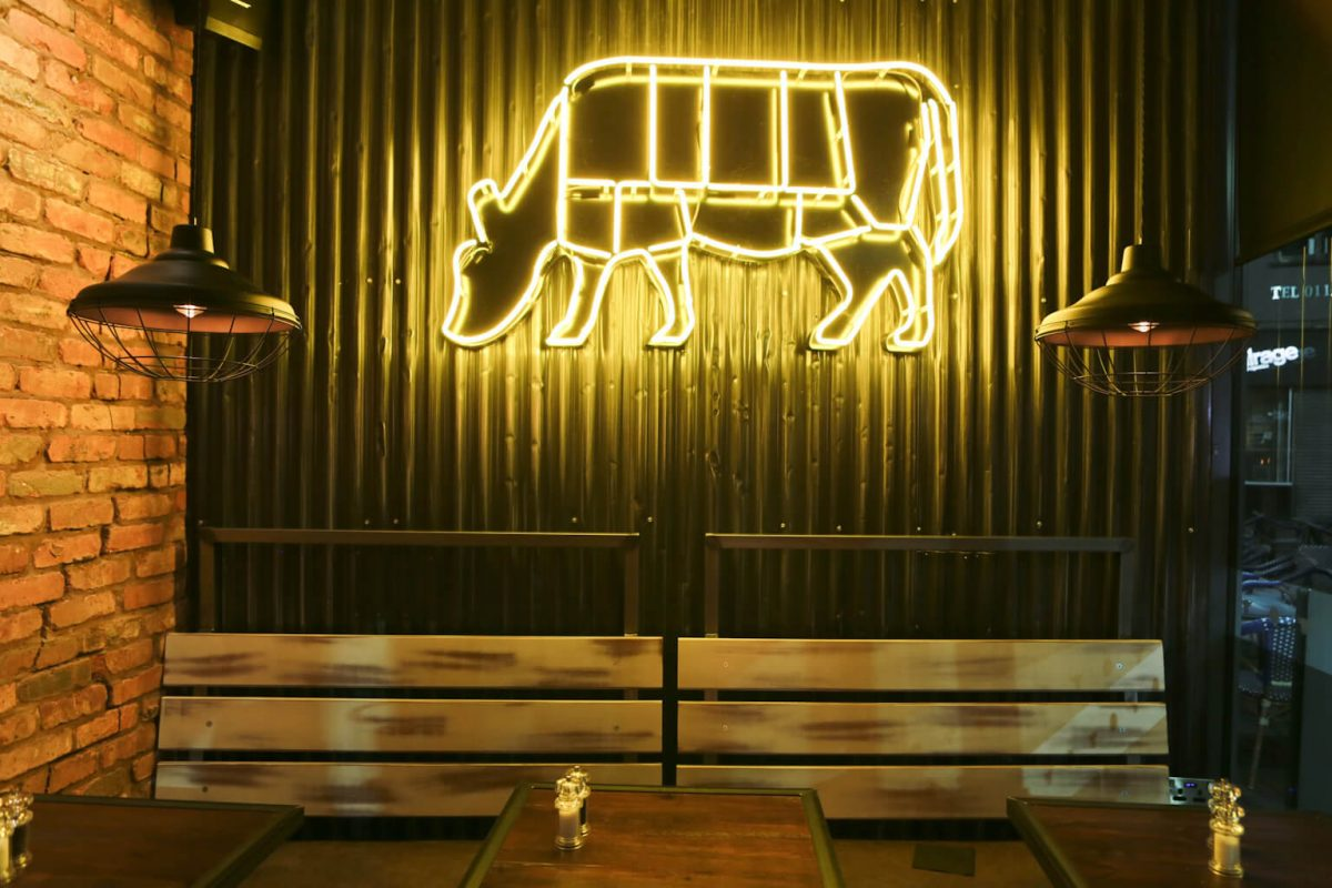 Son of Steak Corugated Iron and neon cow lighting