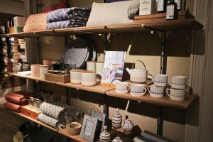 Shelves filled with White Stuff Nottingham New homeware collection displays