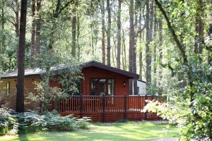 Woodland Lodge exterior at Kelling Heath Holiday Park