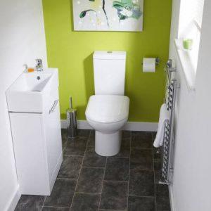 Floorstanding short projection cloakroom basin / sink with vanity in small bathroom ensuite