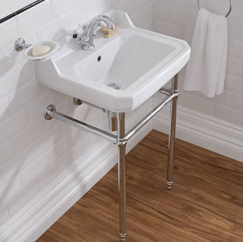 Cloakroom basin with towel rail