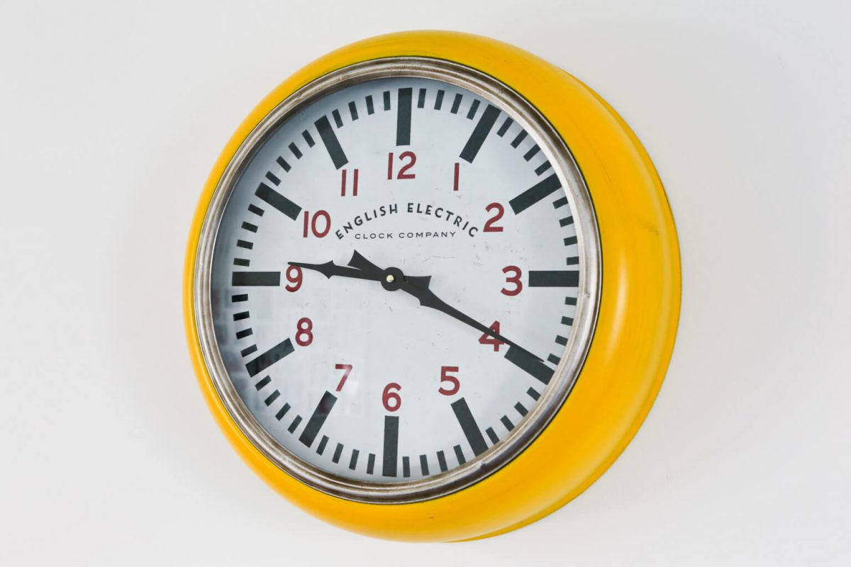 Angle view Big Yellow Large Wall Clock from the English Electric Clock Company