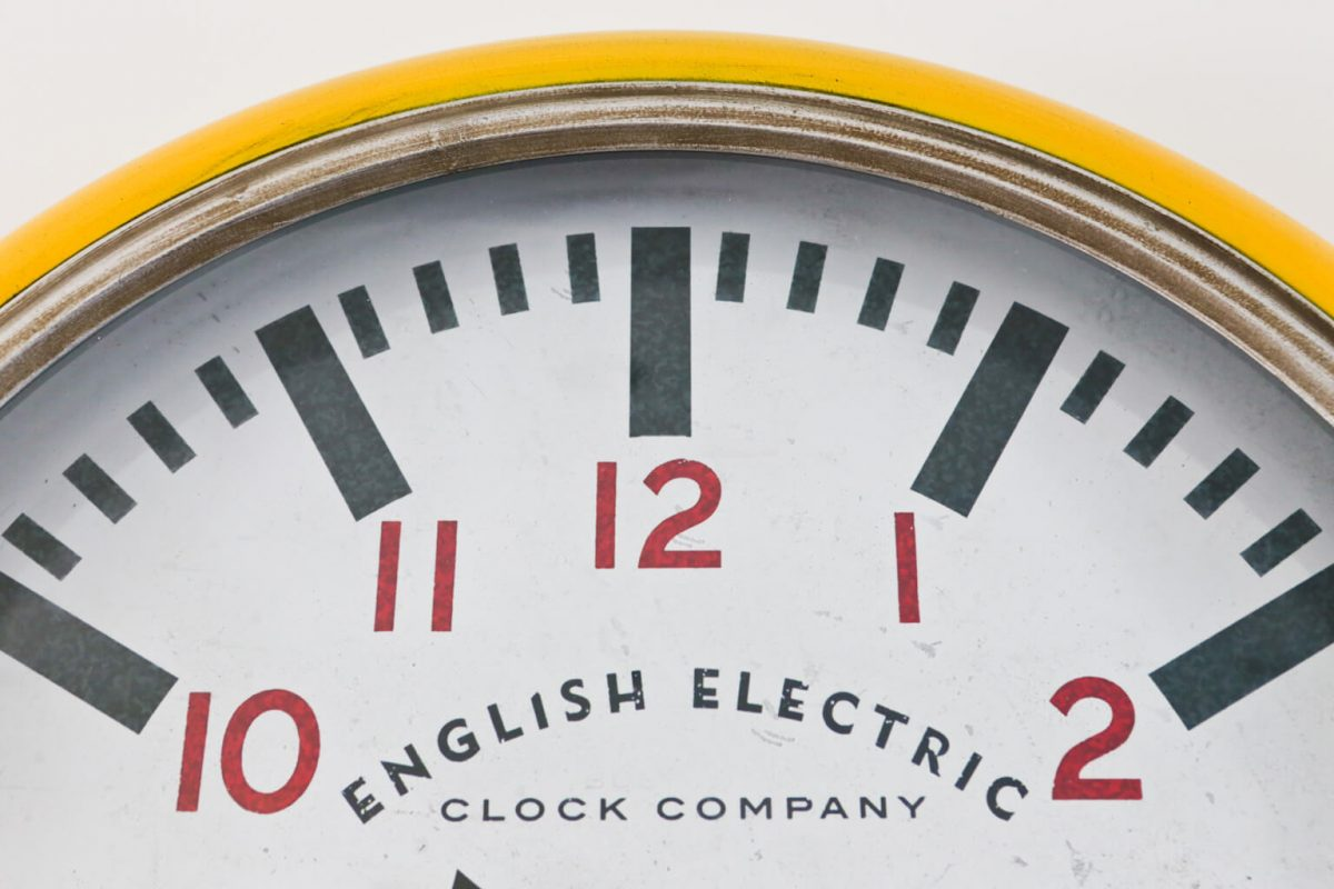 CLose-up Big Yellow Large Wall Clock from the English Electric Clock Company