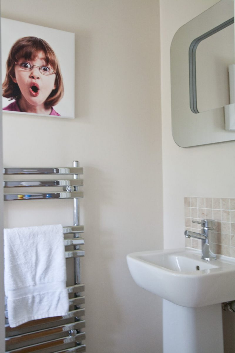 Our Cloakroom with cloakroom basin, chrome towel rail