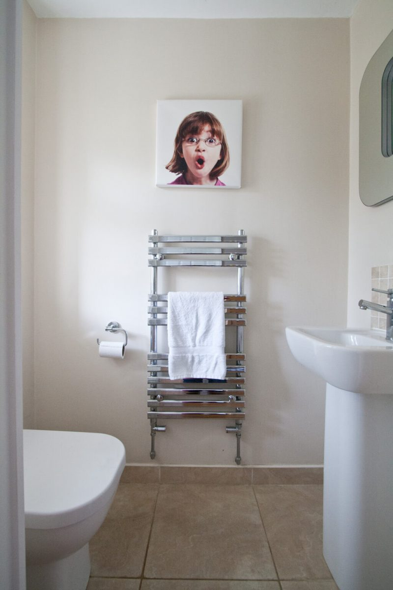Our downstairs toilet with cloakroom basin, chrome towel rail and back-to-wall wc