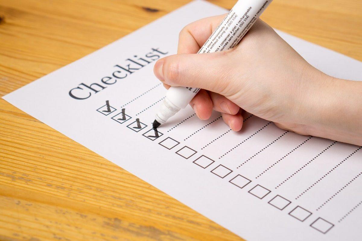 Someone ticking a checklist
