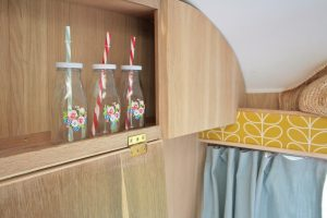 1969 Cheltenham Fawn Renovation Project After Oak Wall cupboards with patterned milk bottles