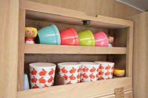 1969 Cheltenham Fawn Renovation Project After : Wall cupboard with brightly coloured cups in