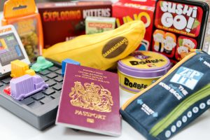 Top 10 Must have Travel games for family holidays : Including Dobble, Uno, Bananagrams, Zip-it, Shuffle Monopoly, Exploding Kittens, Sushi Go, Rush Hour, Top Trumps, Pass the pigs.
