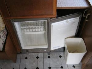 1969 Cheltenham Fawn Renovation Project Before: white and black lino and old fridge