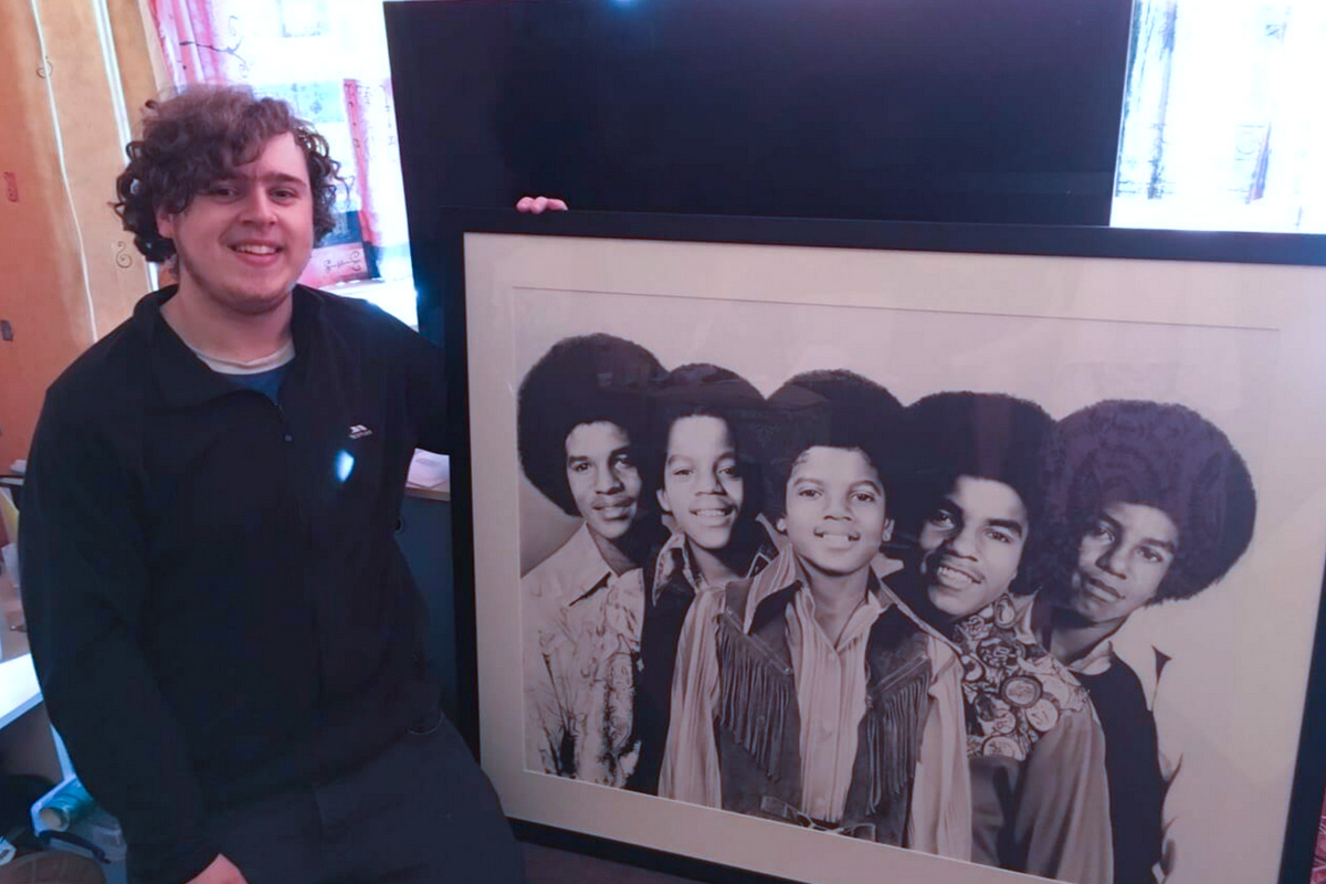 Chris Baker and his Print of The Jacksons