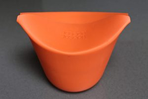 Joseph Joseph M-Cuisine Popcorn Maker single serve orange container with flaps folded dorn