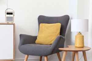 VQ Monty DAB Digital Radio with grey chair and orange cushion and lamp Scandi style