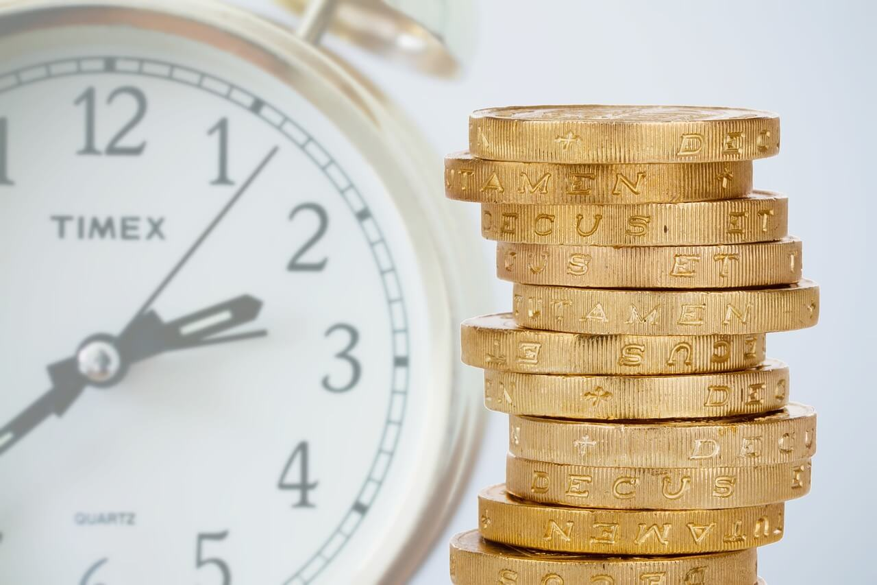 Coins and a Clock close-up