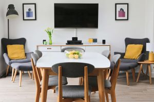 Yellow and Grey themed dining room using some of the latest styled to sell trends