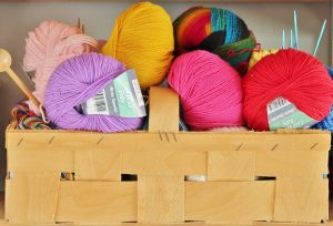 Coloured wool in a wooden basket