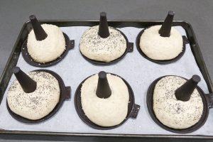 Sprinkle sesame seeds or poppy seeds on the bagels prior to baking
