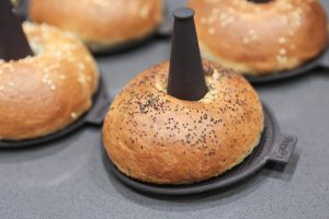 Close-up of The golden brown, crispy sesame and poppy seed bagels on Lékué silicone bagel moulds