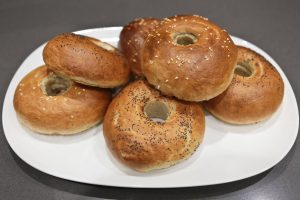 Crisp, golden brown sesame and poppy seed bagels on The golden brown, crispy sesame and poppy seed bagels on Lékué silicone bagel moulds
