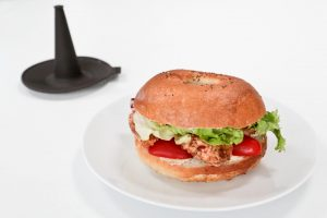 A poppy seed bagel sandwich made with a Lékué silicone bagel moulds
