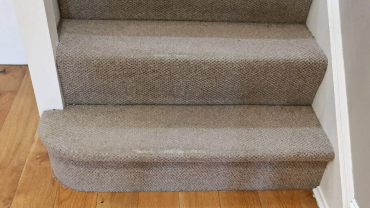 Worn carpet on stairs
