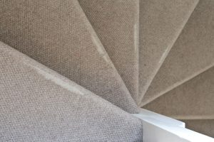 Worn carpet on high traffic areas like stairs