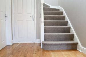 Our stair carpet is worn out and needs replacing. view of stairs from hallway