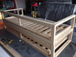 Back view of DIY Sofabed frame with trundle bed underneath with sprung slats