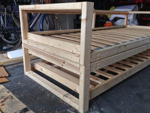 Side view of DIY sofabed frame. The legs were part of a rectangular frame