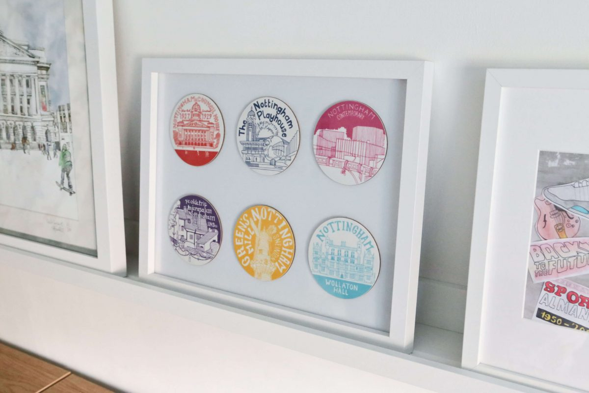 Close-up of Nottingham Coasters Finished Gallery wall using Ikea Mosslanda Picture ledges