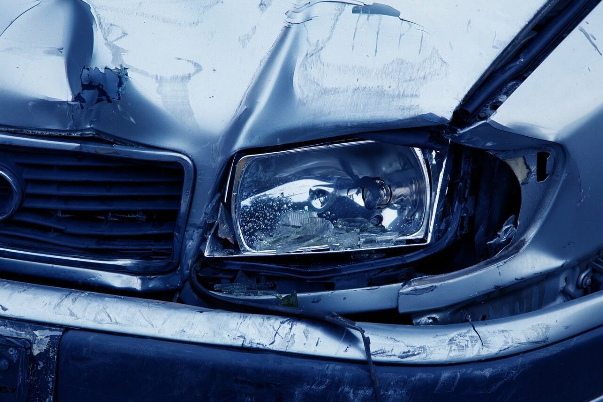 Smashed car headlamp on blue car