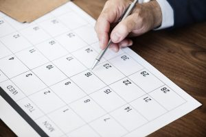 Close-up of someone planning ahead on a calendar