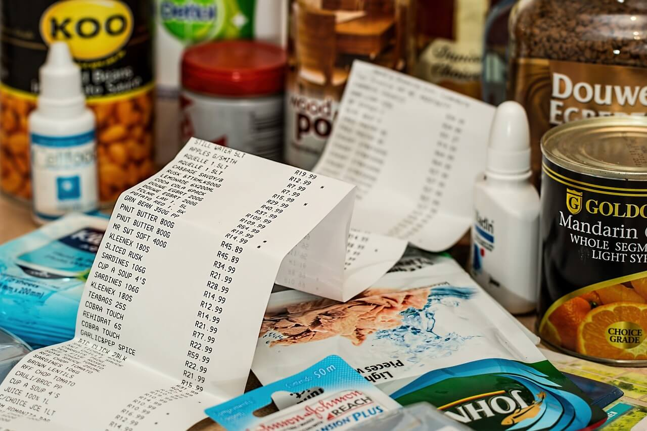 Till receipt surrounded by grocery shopping